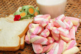 Fresh milk and pink marshmallows with a slice of bread.  — Stock Photo