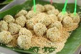 Thailand sweets - boiled sweets put sesame. — Stock Photo