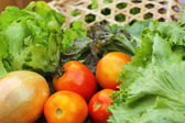 Vegetables salad and tomato in the basket — Stock Photo