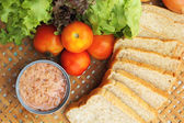 Making tuna sandwich with fresh vegetables — Stock Photo