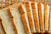 Whole wheat bread sliced on a basket — Stock Photo