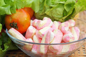 Vegetables salad, tomato and pink marshmallows.  — Stock Photo