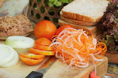 Making tuna sandwich with fresh vegetables  — Stock fotografie