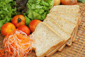 Fresh vegetables salad with whole wheat bread.  — Stock Photo