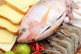 Fresh fish, squid, shrimp, streaky pork, sausages - for cooking. — Stock Photo