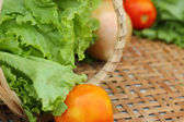Vegetables salad and tomato in the basket — Stockfoto