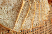 Whole wheat bread sliced on a basket — Foto Stock