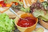 Making tuna sandwich with fresh vegetables  — Stockfoto