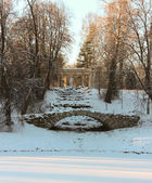 View with Hump Bridge and Apollo Colonade in Pavlovsky Park on J — Stock Photo