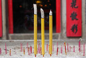 Smoldering Chinese candles at Sam Seng Temple — Stock Photo