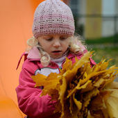 Girl with autumn leaves — Stock Photo