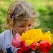 Child with tulips — Stock Photo