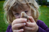 Child and a snail — Stock Photo