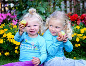 Two blond girls and apple — Stock Photo