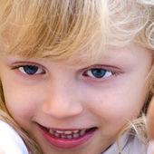 Child with beautiful big blue eyes — Stock Photo