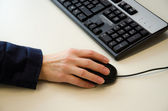 Hands on mouse and keyboard — Stock Photo