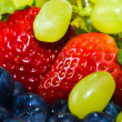 Foto Stock: Strawberry, grape and bilberry