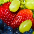 Stok fotoğraf: Strawberry, grape and bilberry