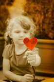 Child with heart lollipop — 图库照片