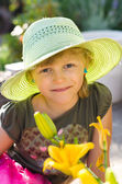 Girl with hat and flower — Stock Photo