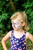 Child with face painting — Stock Photo