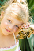 Beautiful blond girl with turtle — Photo