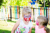 Girls with butterfly face painting — Stock Photo