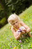 Blond girl on grass — Stock Photo