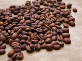 Photo of coffee beans on gold background — Stock Photo