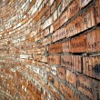Brick wall with cyrillic names — Stockfoto