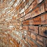 Brick wall with cyrillic names — Stock Photo #35102087