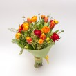 Small bouquet from ranunculus and tulips — Stock Photo #36419601