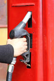 Hand of male holding a fuel pump — Stock Photo