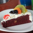 Colorful mix fruit chocolate cake — Stock Photo