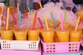 Plastic cup of Orange juice  — Stock Photo