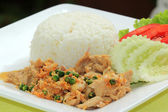 Stir fried pork with garlic serve with steam rice  — ストック写真