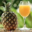 Fresh pineapple and juice — Stock Photo #41236377