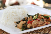 Fried basil chicken and rice — Stock Photo