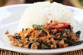 Pad Krapao Moo, spicy stir-fried pork with Thai Holy basil — Stock Photo