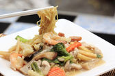 Chinese style stir fried yellow noodles with in gravy sauce — Stock Photo