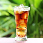 Cola with ice cube — Stock Photo