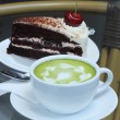 Green tea and Black forest cake — Stock Photo