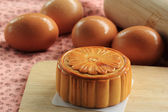 Moon cakes and egg background — Stock Photo