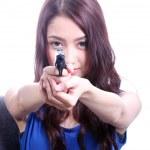Asian Woman with handgun on white — Stock Photo #42039995
