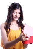 Asian beautiful woman opening a chocolate box — Stock Photo