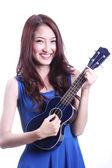 Woman playing ukulele — Stock Photo
