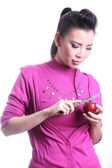 Asian woman casing apple — Stock Photo