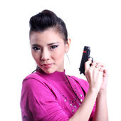 Asian woman holding a gun — Stock Photo