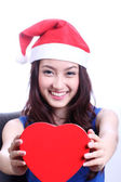 Asian woman with a christmas hat and carrying a chocolate box — Stock Photo
