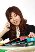 Businesswoman sitting using mobile phone — Foto de Stock